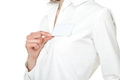 Young woman's hand showing blank name badge Royalty Free Stock Photos