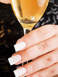 Young woman's hand with wine glass stock images