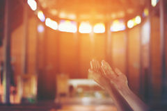 Young woman`s hands clasped in prayer at christ churchใ. Hands of young woman clasped in prayer at christ church royalty free stock photography