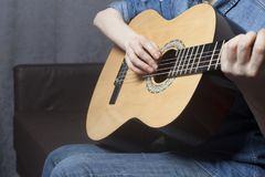 Young woman`s hands playing a acoustic classic guitar stock photos