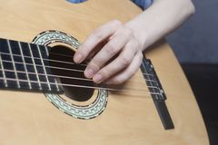 Young woman`s hands playing a acoustic classic guitar royalty free stock photos