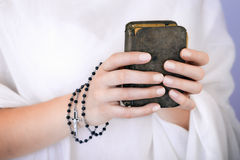 Young woman's hands with a rosary and a bible Royalty Free Stock Photo