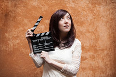 Young woman 70s hippie style closeup with clapperboard Stock Image