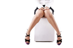 Young woman's legs in fashionable high heel royalty free stock image