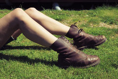 Young woman's legs and feet on the grass royalty free stock image