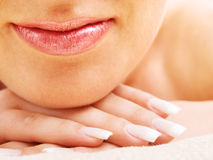 Young woman's lips and hand Royalty Free Stock Photos
