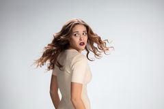 The young woman's portrait with frightened emotions Royalty Free Stock Photo