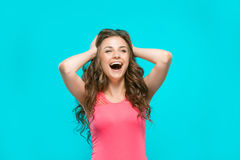 The young woman's portrait with happy emotions. On blue background Stock Photo