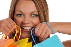 Young woman's portrait with shopping bags Stock Images