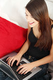 Young woman's working on laptop. Stock Images
