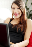 Young woman's working on laptop. Stock Image