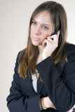 Young woman sad on the phone Stock Photos