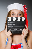 Young woman sailor. With movie board Stock Images