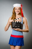 Young woman sailor. With movie board Royalty Free Stock Photo