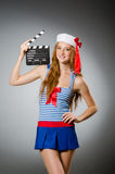Young woman sailor. With movie board Royalty Free Stock Image