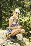 Young woman in sailor outfit posing in summer outdoors Royalty Free Stock Photography