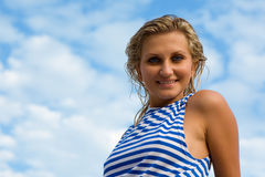 Young woman in sailor's striped vest Stock Photo