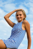 Young woman in sailor's striped vest Royalty Free Stock Image