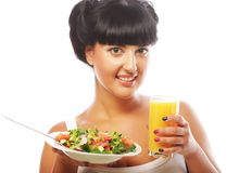 Young woman with salad and orange juice Royalty Free Stock Photo