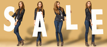 Young woman with sale letters. Young pretty woman with sale letters Royalty Free Stock Image