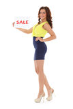 Young  woman with sale sign. Royalty Free Stock Image