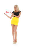 Young  woman with sale sign. Young beautiful  woman with sale sign  on a white background Stock Image