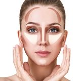 Contour and highlight makeup. Young woman with sample contouring and highlight makeup on face Royalty Free Stock Photo