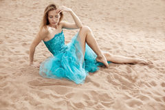 Young woman on the sand Stock Images