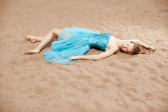 Young woman on the sand Royalty Free Stock Images