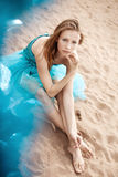 Young woman on the sand Stock Image