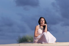 Young woman on a sand dune stock photography