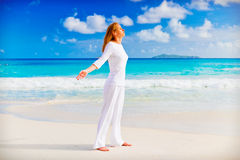 Young woman on the sand near the ocean Royalty Free Stock Photography