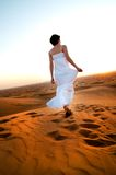 Young woman in sandy desert Royalty Free Stock Photos