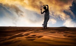 Young woman in sandy desert Stock Image