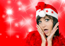 Young woman in santa cap and stars Royalty Free Stock Images