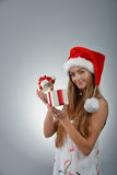 Young woman in santa claus Stock Photography