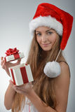 Young woman in santa claus Stock Images