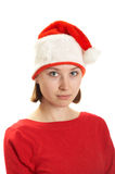 Young woman in a Santa claus cap Royalty Free Stock Image