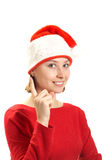 Young woman in a Santa claus cap Stock Image