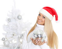 Young woman in Santa Claus cap Stock Photos