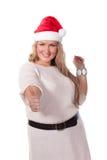 Young woman in Santa Claus cap. Royalty Free Stock Image