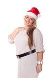 Young woman in Santa Claus cap. Stock Photos