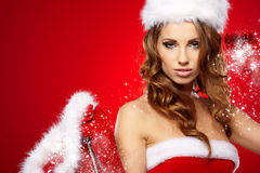 Young woman in Santa Claus clothes Stock Photography