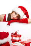 Young woman in Santa Claus clothes Stock Photos