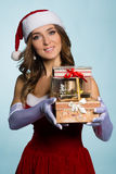 Young woman in Santa Claus clothes with gifts stock photos