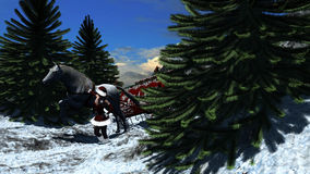 Young woman in Santa Claus clothes over snowy mountains Royalty Free Stock Image