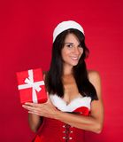 Young Woman In Santa Claus Costume Holding Present Stock Photos