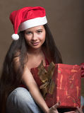 Young woman in Santa Claus hat Royalty Free Stock Image