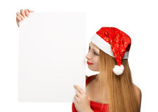 Young woman in santa claus hat with christmas card Royalty Free Stock Images