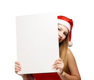 Young woman in santa claus hat with christmas card Royalty Free Stock Photos